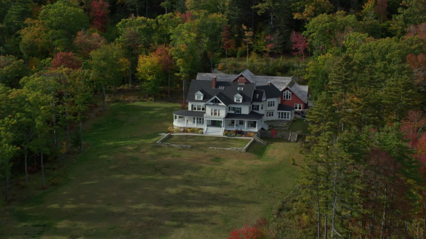 6k stock footage aerial video approaching an isolated rural home, colorful foliage, autumn, Camden, Maine Aerial Stock Footage | AX148_113