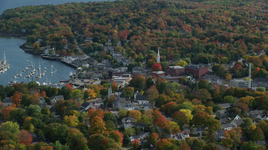6k aerial video orbiting small coastal town, Camden Harbor, autumn, Camden, Maine Aerial Stock Footage | AX148_114