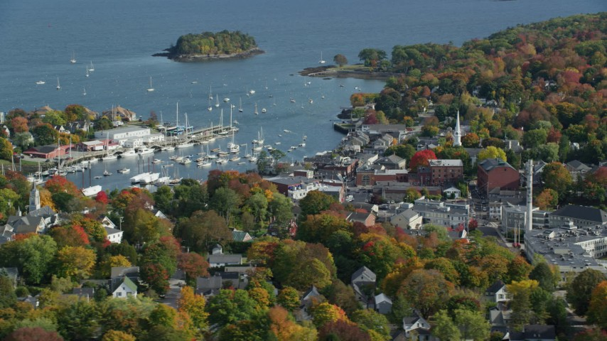 6k aerial video orbiting small coastal town, Camden Harbor, autumn, Camden, Maine Aerial Stock Footage | AX148_115