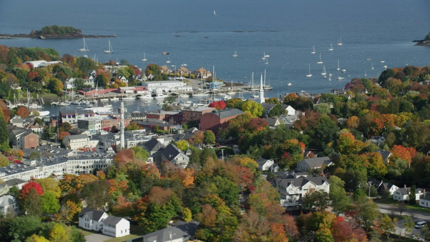 6k stock footage aerial video orbiting a small coastal town, Camden Harbor, autumn, Camden, Maine Aerial Stock Footage | AX148_116