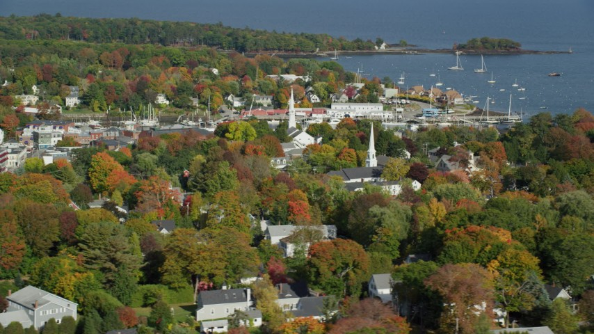 6k aerial video orbiting a small coastal town, Camden Harbor, autumn, Camden, Maine Aerial Stock Footage | AX148_117