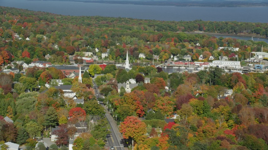 6k aerial video orbiting a small coastal town in autumn, Camden, Maine Aerial Stock Footage | AX148_118
