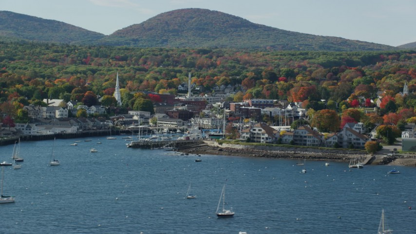 6k aerial video flying by small coastal town, boats, autumn, Camden, Maine Aerial Stock Footage | AX148_122