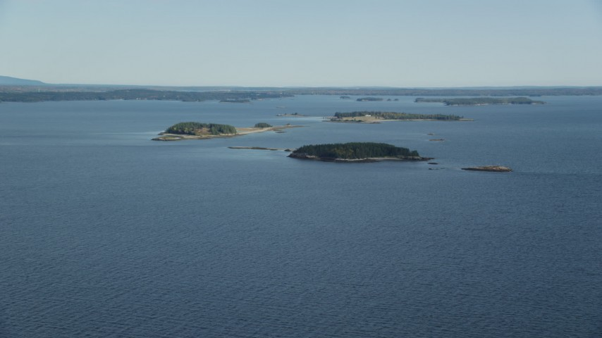 6k stock footage aerial video approaching small islands, Hog Island, Maine Aerial Stock Footage | AX148_129