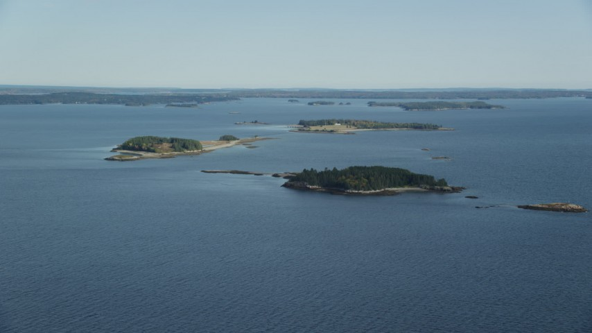6k stock footage aerial video approaching small islands, trees, Hog Island, Maine Aerial Stock Footage | AX148_130