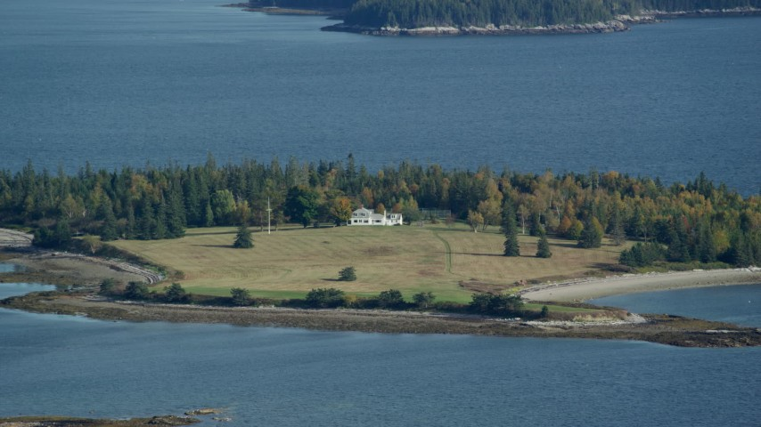 6k stock footage aerial video approaching an isolated homes, autumn, Hog Island, Maine Aerial Stock Footage | AX148_132