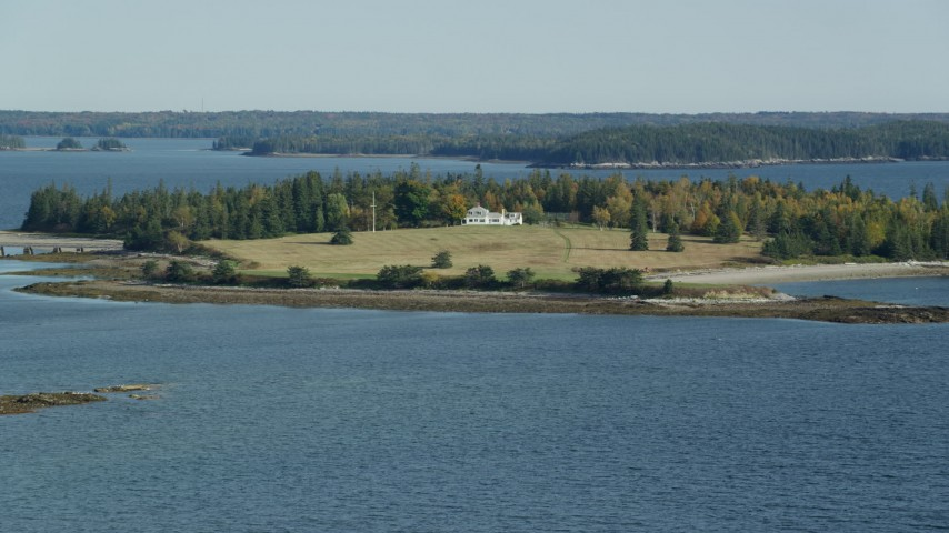 6k stock footage aerial video approaching an isolated island home in autumn, Hog Island, Maine Aerial Stock Footage | AX148_133
