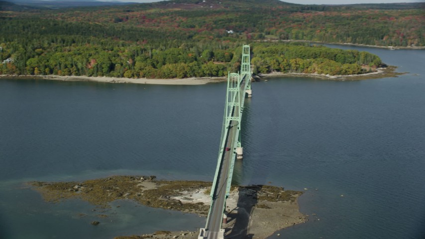 6k stock footage aerial video orbiting the Deer Isle Bridge in autumn, Deer Isle Bridge, Maine Aerial Stock Footage | AX148_139