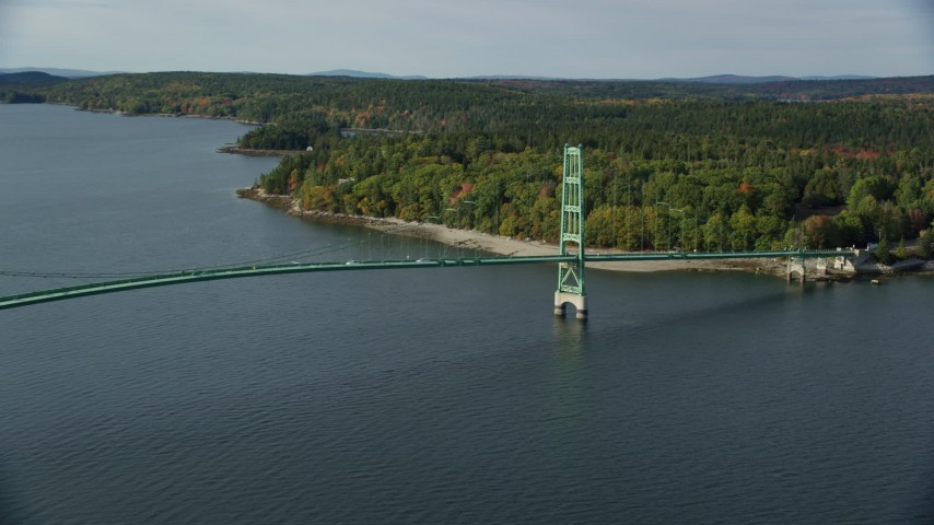 6k stock footage aerial video flying by the Deer Isle Bridge in autumn, Little Deer Isle, Maine Aerial Stock Footage | AX148_140