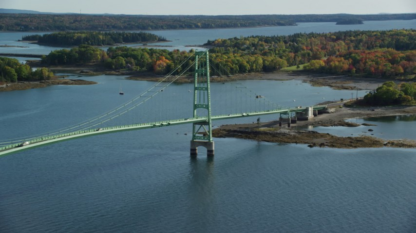 6k stock footage aerial video lying by the Deer Isle Bridge, colorful foliage, autumn, Maine Aerial Stock Footage | AX148_143