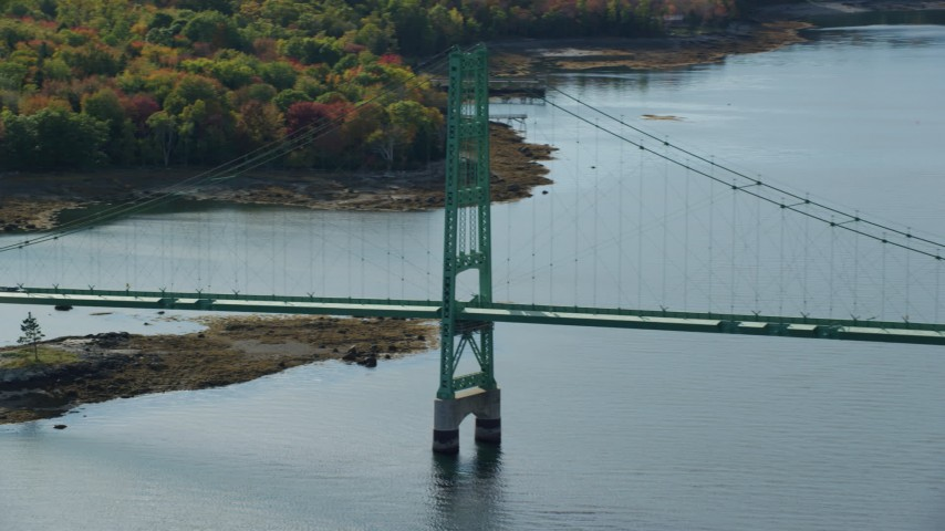 6k stock footage aerial video flying away from Deer Isle Bridge, autumn, Little Deer Isle, Maine Aerial Stock Footage | AX148_145