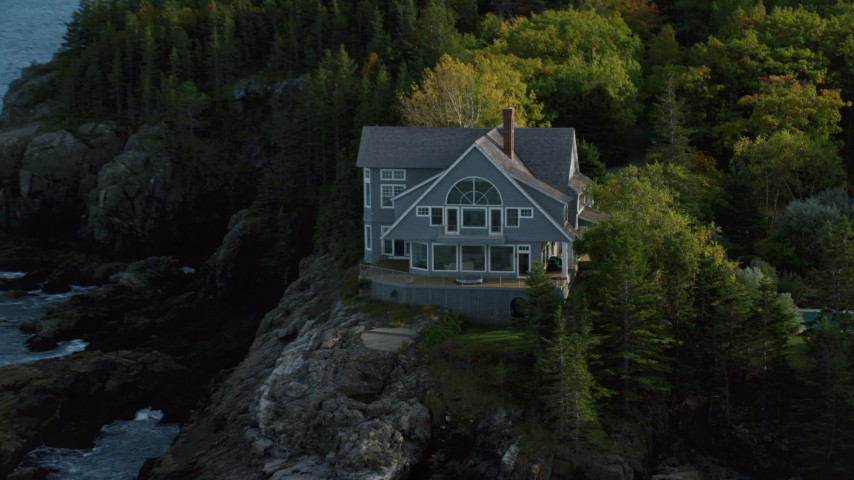 Flying away from waterfront mansion, revealing coast, autumn, Bar Harbor, Maine Aerial Stock Footage | AX148_185