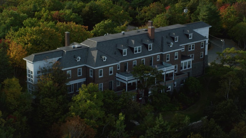 Approaching waterfront mansion atop a rocky coastline, autumn, Bar Harbor, Maine Aerial Stock Footage | AX148_186