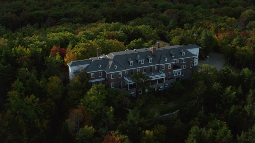 Flying by an isolated mansion, pan right, autumn, Bar Harbor, Maine Aerial Stock Footage | AX148_187