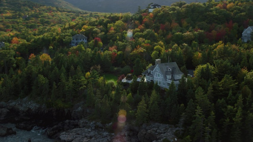 6K aerial video flying by waterfront mansion, rocky coat, autumn, Bar Harbor, Maine Aerial Stock Footage | AX148_190