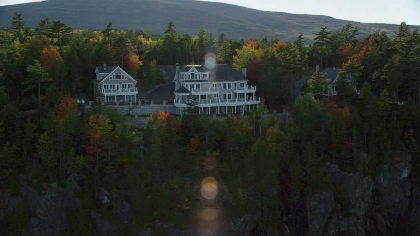 Flying by waterfront homes, autumn, Bar Harbor, Maine Aerial Stock Footage | AX148_191