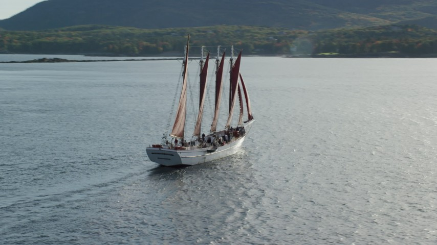 Sailing ship and partial fall foliage, Bar Harbor, Maine Aerial Stock Footage | AX148_198