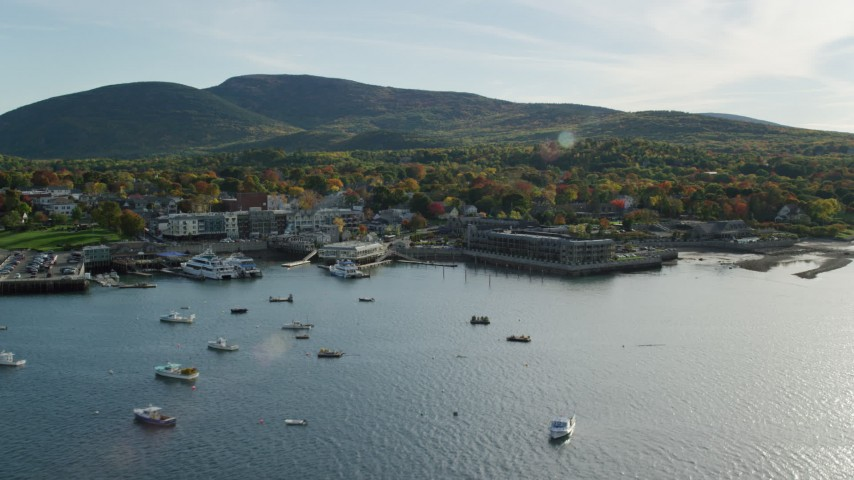 Approaching Harborside Hotel, Spa and Marina in autumn, Bar Harbor, Maine Aerial Stock Footage | AX148_201
