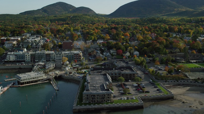 6K stock footage aerial video approaching Harborside Hotel, Spa and Marina in autumn, Bar Harbor, Maine Aerial Stock Footage | AX148_201
