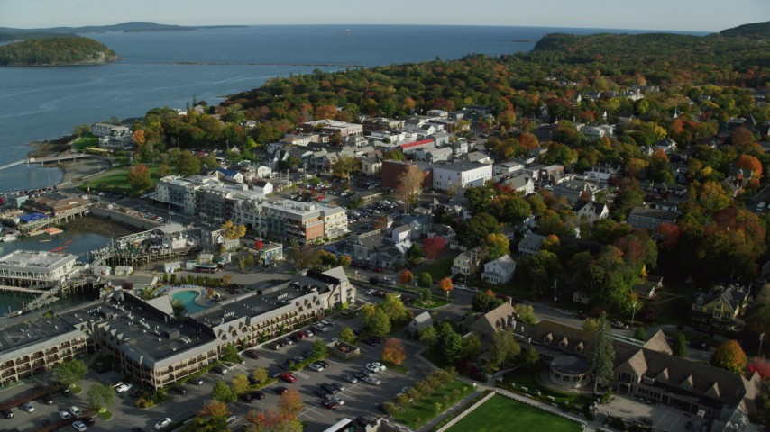 6K stock footage aerial video orbiting Harborside Hotel, Spa & Marina in coastal town, autumn, Bar Harbor, Maine Aerial Stock Footage | AX148_202
