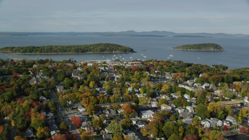 6K stock footage aerial video flying over coastal town with fall foliage near harbor, Bar Harbor, Maine Aerial Stock Footage AX148_205 | Axiom Images