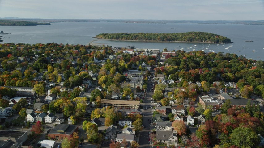 Fly over Main Street in a coastal town in autumn, Bar Harbor, Maine Aerial Stock Footage | AX148_206