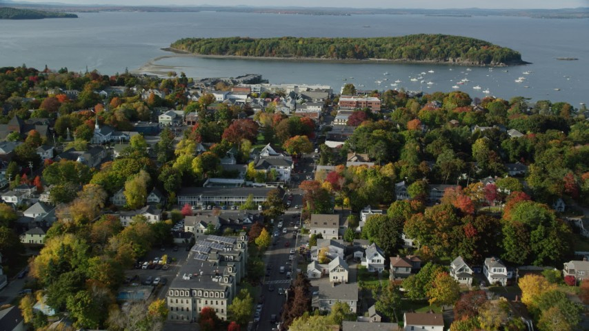6K stock footage aerial video flying toward harbor over Main Street in coastal town, autumn, Bar Harbor, Maine Aerial Stock Footage | AX148_207
