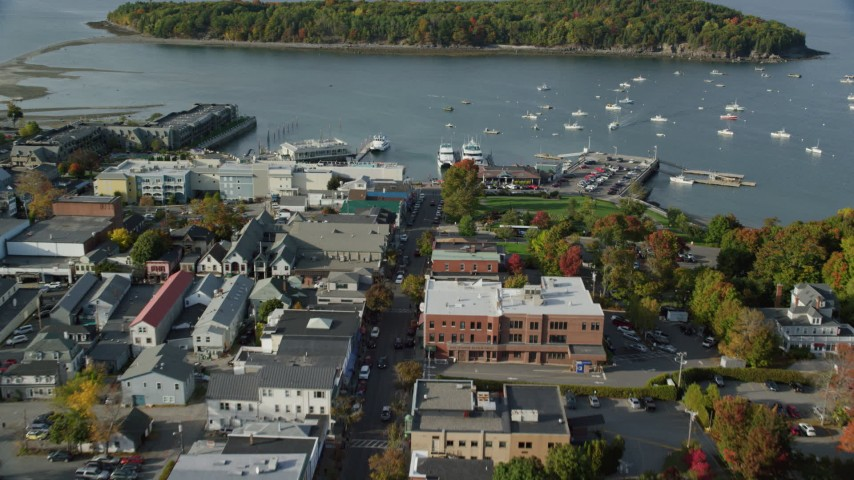 Approach harbor with boats from coastal town, autumn, Bar Harbor, Maine Aerial Stock Footage | AX148_208