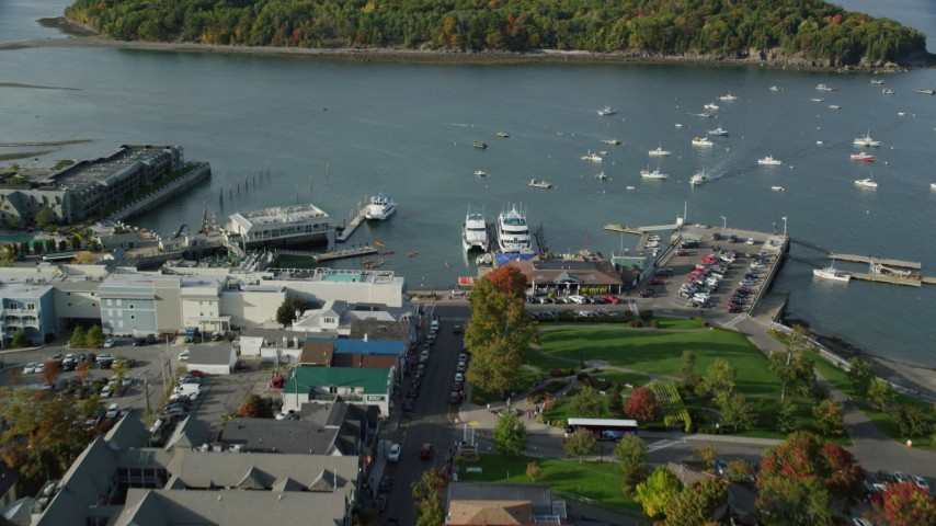 6K aerial video approaching harbor with boats from coastal town, autumn, Bar Harbor, Maine Aerial Stock Footage | AX148_208