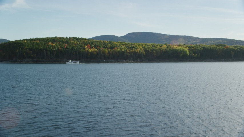 6K aerial video approaching Bar Island with fall foliage, Bar Harbor, Maine Aerial Stock Footage | AX148_210