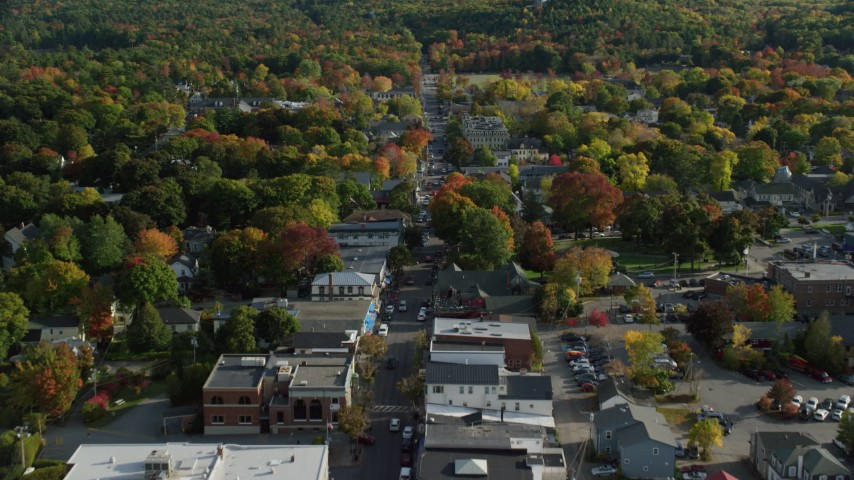 Fly over Main Street of a small coastal town with fall foliage, Bar Harbor, Maine Aerial Stock Footage | AX148_214
