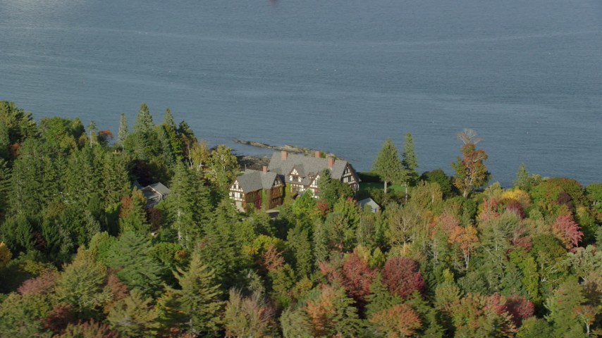 Orbiting isolated waterfront home among partial fall foliage, Bar Harbor, Maine Aerial Stock Footage | AX148_216