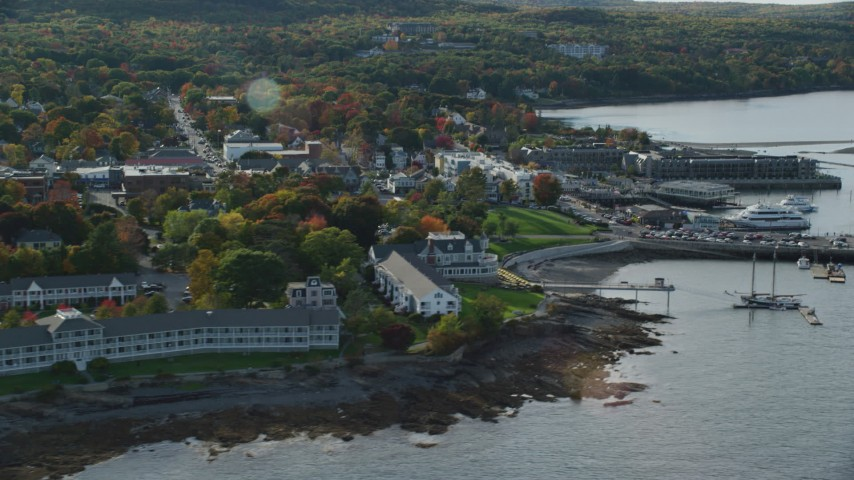 Fall foliage in a coastal town near the harbor, Bar Harbor, Maine Aerial Stock Footage | AX148_219