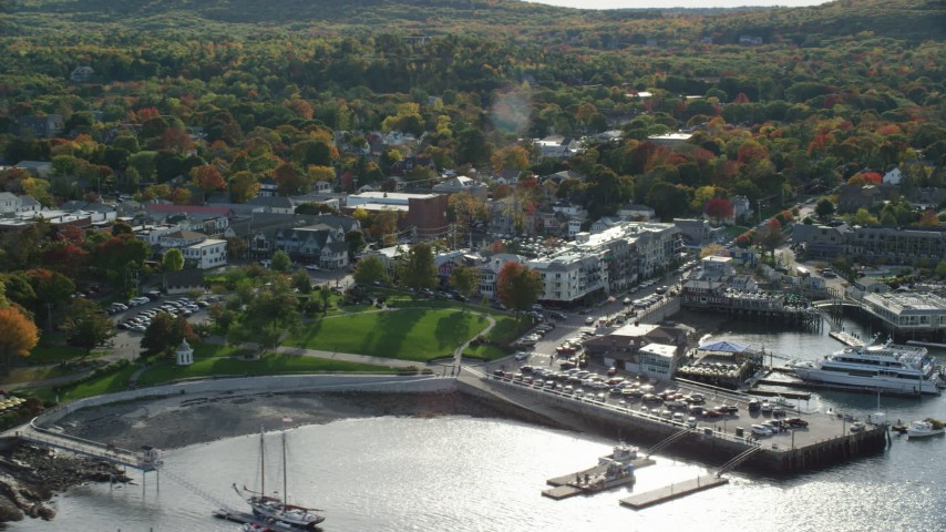 6K aerial video of fall foliage in a small coastal town along the harbor, Bar Harbor, Maine Aerial Stock Footage | AX148_220