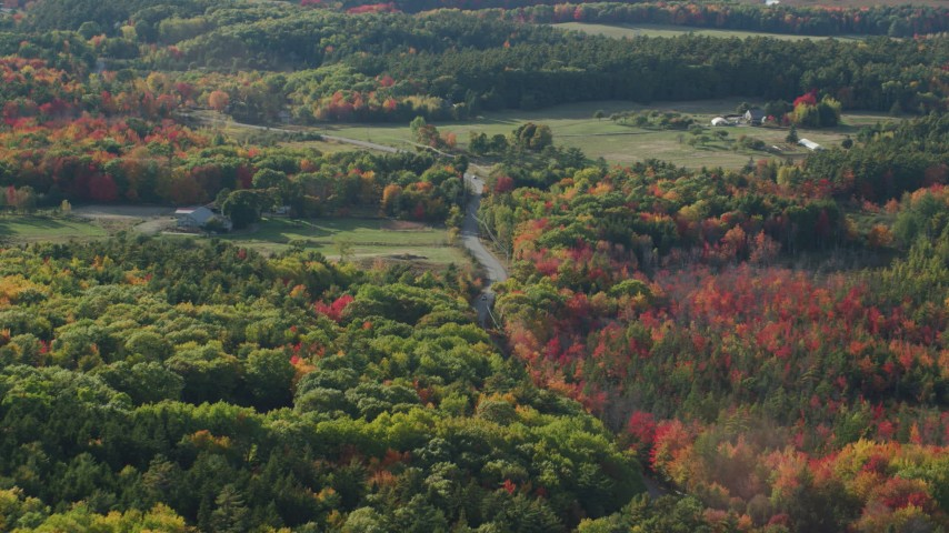 Following a road through the countryside with fall foliage, Bar Harbor, Maine Aerial Stock Footage | AX148_228