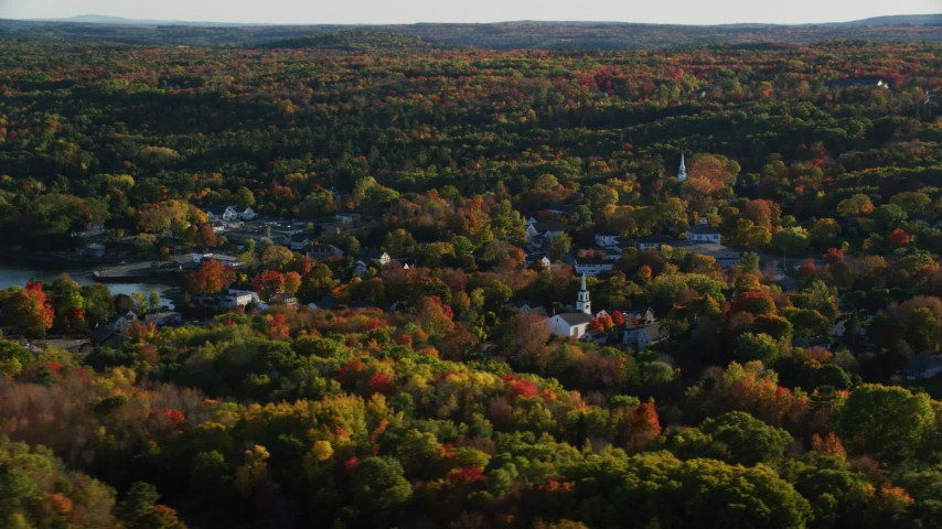 6K stock footage aerial video flying by quaint coastal town among fall foliage, Blue Hill, Maine Aerial Stock Footage | AX149_017