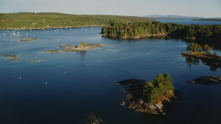 6K stock footage aerial video flying over water toward tiny islands and trees, autumn, Blue Hill, Maine Aerial Stock Footage AX149_023 | Axiom Images