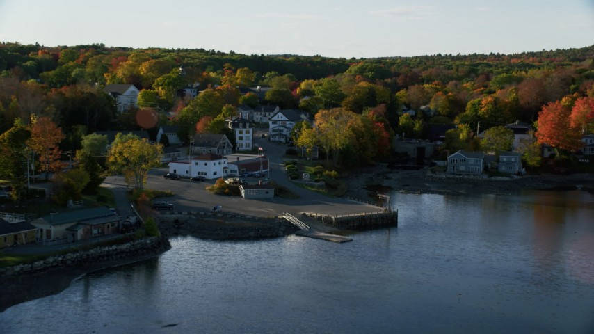 6K aerial video approaching houses and streets in a coastal town, autumn, Blue Hill, Maine Aerial Stock Footage | AX149_027