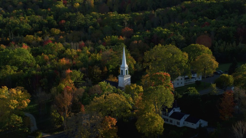 6K aerial video orbiting church steeple in a small town with fall foliage, Blue Hill, Maine Aerial Stock Footage | AX149_028