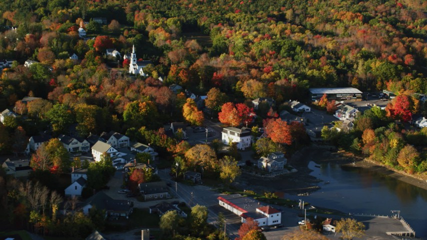 6K aerial video passing by a small coastal town and fall foliage, Blue Hill, Maine Aerial Stock Footage | AX149_031