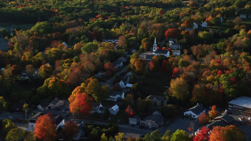 6K stock footage aerial video orbiting homes and white church in small coastal town, Blue Hill, Maine Aerial Stock Footage | AX149_032