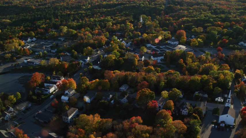 6K stock footage aerial video flying over small coastal town homes and streets in autumn, Blue Hill, Maine Aerial Stock Footage | AX149_033