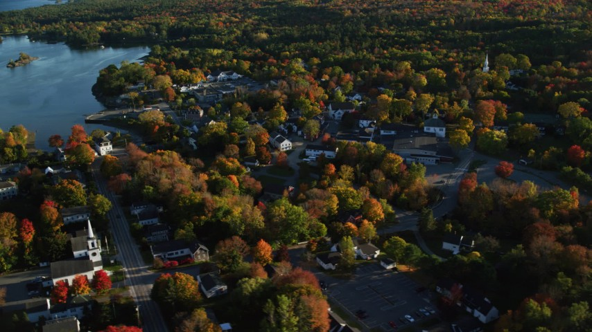 6K aerial video orbiting away from coastal town in autumn, Blue Hill, Maine Aerial Stock Footage | AX149_034