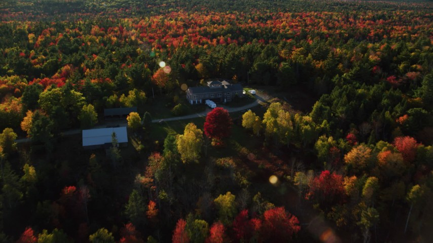 6K stock footage aerial video flying over and tilt down on isolated home among fall foliage, Blue Hill, Maine Aerial Stock Footage | AX149_038