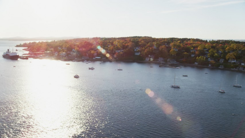 6K aerial video flying by a small coastal town, State of Maine training ship, autumn, Castine, Maine Aerial Stock Footage | AX149_069