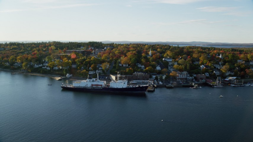 6K aerial video orbiting small coastal town, State of Maine training ship, autumn, Castine, Maine Aerial Stock Footage AX149_070