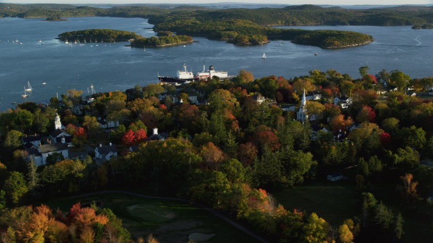 6K aerial video orbiting a small coastal town and training ship, autumn, Castine, Maine Aerial Stock Footage | AX149_076