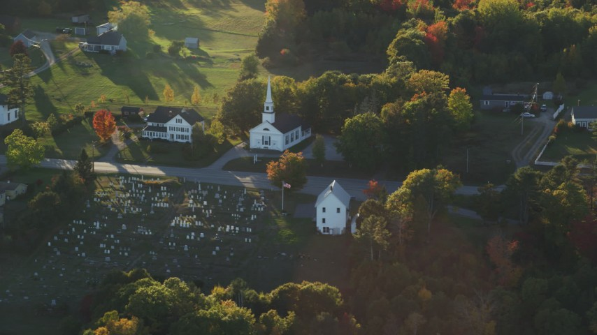 6K aerial video flying by small church and cemetery, autumn, Stockton Springs, Maine Aerial Stock Footage | AX149_092