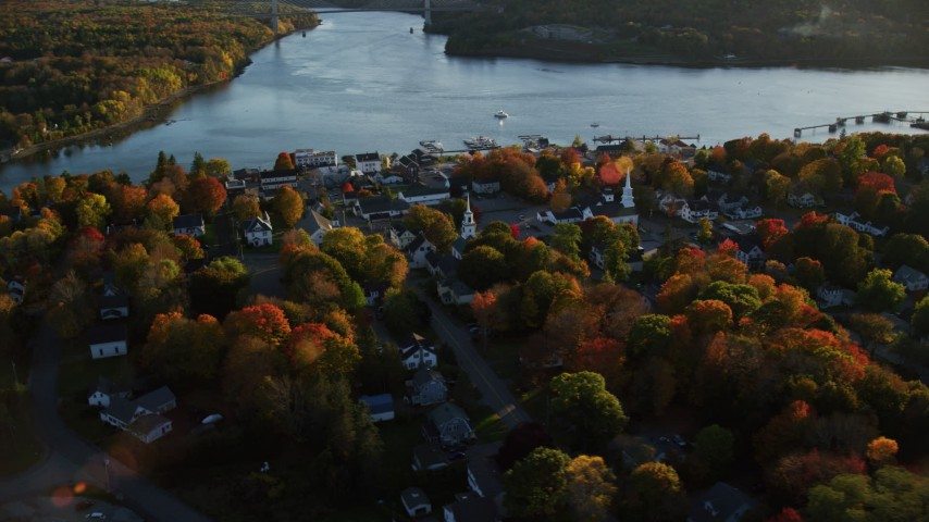 6K aerial video orbiting a small coastal town on the Penobscot River, autumn, Bucksport, Maine Aerial Stock Footage | AX149_106