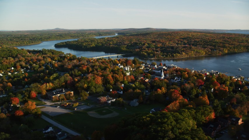 6K aerial video flying away from small coastal town, Penobscot River, autumn, Bucksport, Maine Aerial Stock Footage | AX149_107